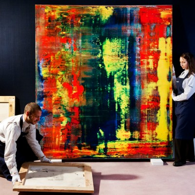 Gallery technicians hanging a picture by Gerhard Richter at Sotheby's